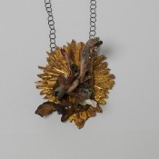 Out of Framework    .      Necklace         2014         Wood, color, silver, plastic, iron, brass, fabric, gold leaf        450X110X80mm
